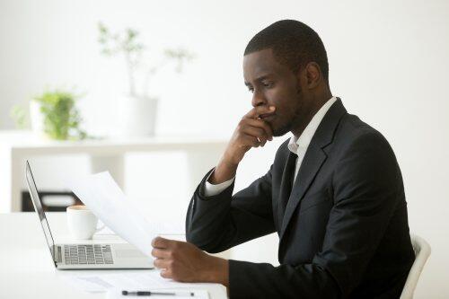 Businessman pondering decision for blog post