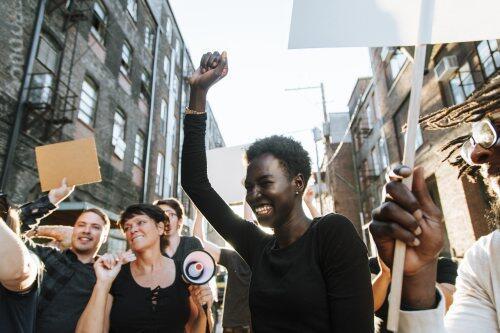 Happy female demonstrator for blog post