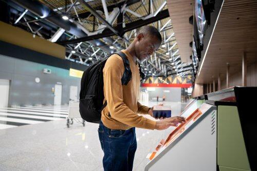 Passenger using self check-in kiosk for blog post