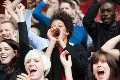 Woman cheering in stadium