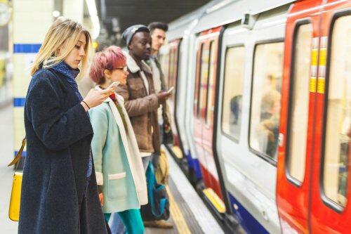 Rail passengers waiting on a platform for blog post