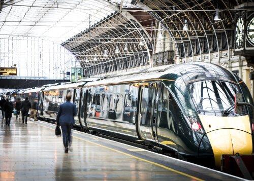 Man walking on train platform for blog post